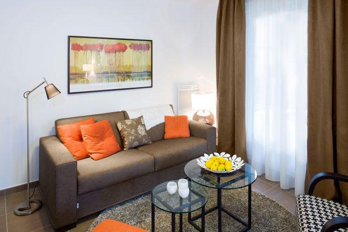 Salon d'un appartement de la résidence Le Jardin d'Aragon